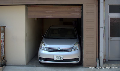 A car parked in a very narrow garage in Nagasaki, Japan in March 2015