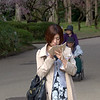 Woman with a smartphone at the botanical gardens in Kyoto, Japan in March 2015