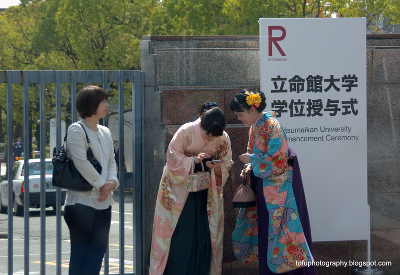 Women in kimonos outside a university following a graduation ceremony in Kyoto, Japan in March 2015