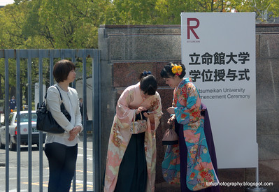 Women in kimonos outside a university following a graduation ceremony in Kyoto, Japan in March 2015