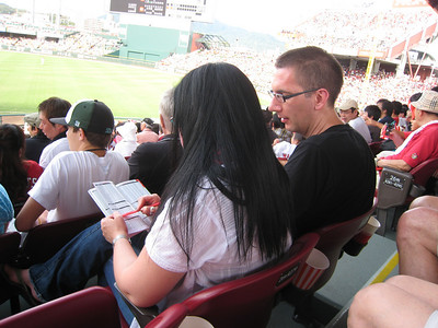Susan and Mark consulting the media guide