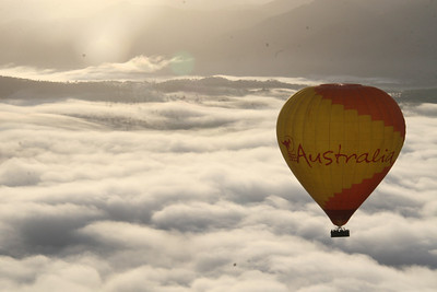 Gently floating above the clouds in a hot air balloon