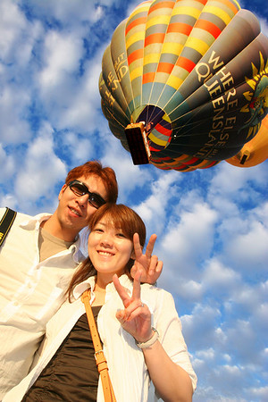 A happy Japanese couple Hot Air Ballooning