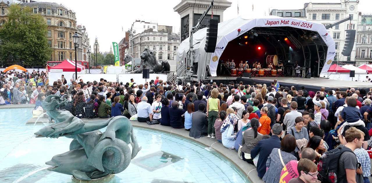 Wide shot from fountain to stage