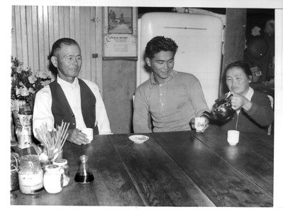 """Afternoon tea at the home of the Dote family in Los Angeles.  Left to right:  Nasaichi Dote (Issei), father"