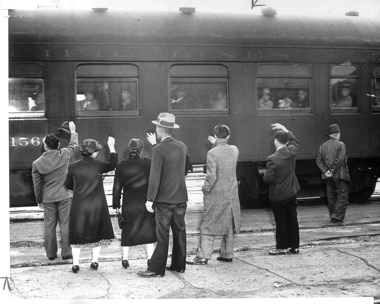 """""""Families and friends of the Japs who departed by train line the platform to bid them good-by for the duration of the war.  There were 500 men in this contingent.""""--caption on photograph"""