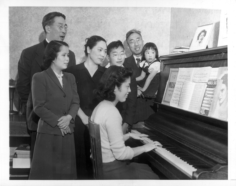 """""""They're Japanese -- but loyal Americans.  Some of the nation's most loyal citizens are those of Japanese, German and Italian descent"""" -- caption on photograph"""