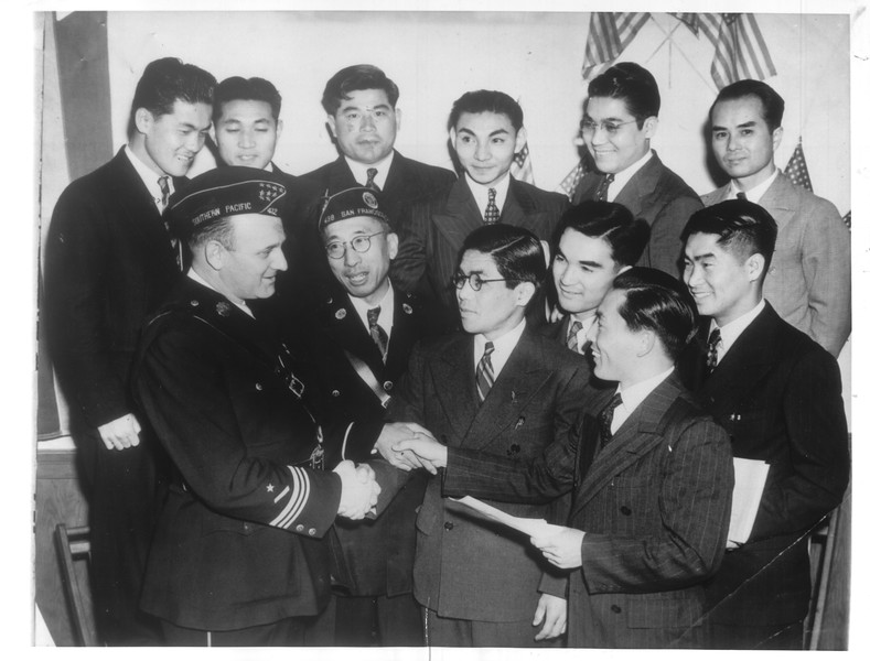 """Charles Kleupfer [...] and Kay Tsukomoto [...] welcome Japanese draftees at a banquet sending them off to the Army."" -- caption on photograph"
