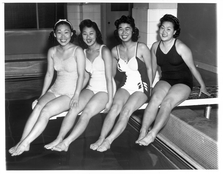 """""""Japanese swimmers.  Left to right:  Sue Noma, Maye Noma, Shigeko Oi and Lily Takeda.  All are Nisei.""""--caption on photograph"""