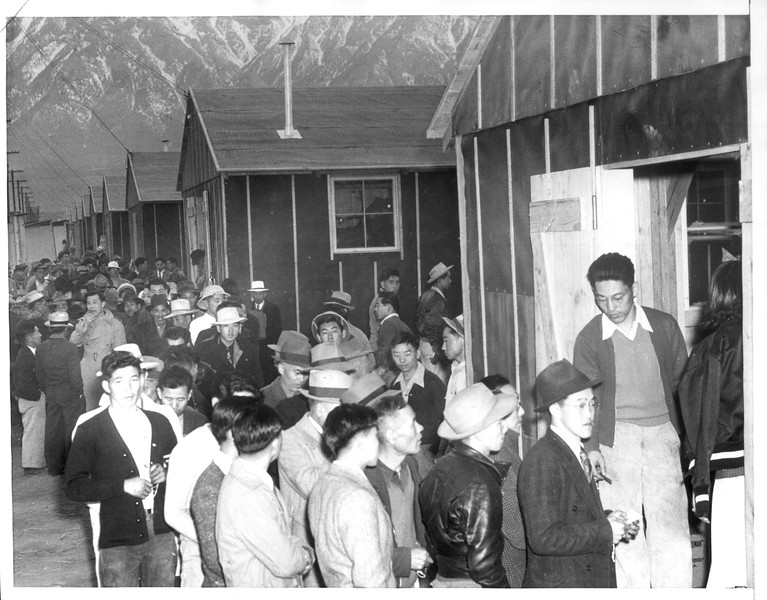 """""""Japanese Arrive at Reception Center -- Ordered from their homes in Los Angeles by the Army"""" -- caption on photograph"""