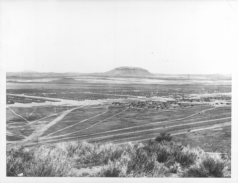"""General view of the center and barracks area looking approximately south east from a sentry tower.""--caption on photograph"