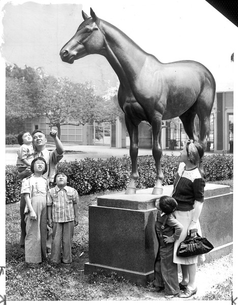 """""""Seabiscuit's Statue Interests Japanese"""" -- caption on photograph"""