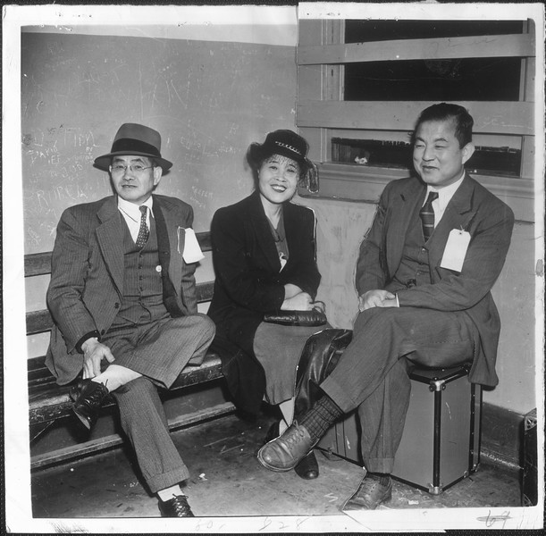 """Arrested yesterday during the sweeping Southland raids, these three smiling Japanese are shown in custody.  They are, left to right, Frisco Tokichi Hasegawa, retired dry goods man"
