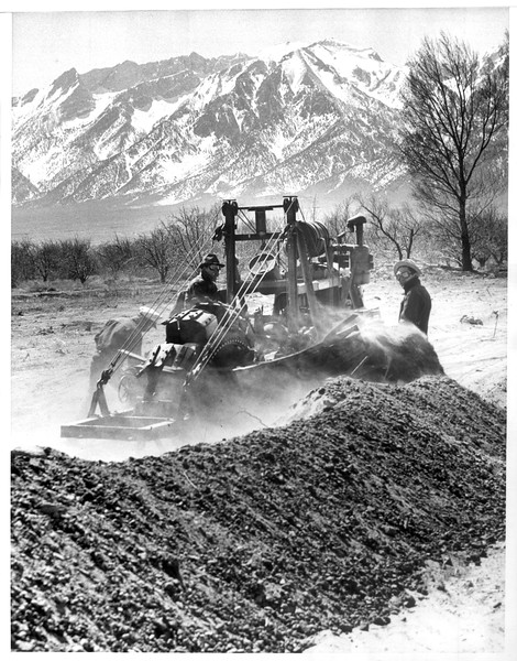 """""""Laying Water Line For Japanese Boom Town"""" -- caption on photograph"""