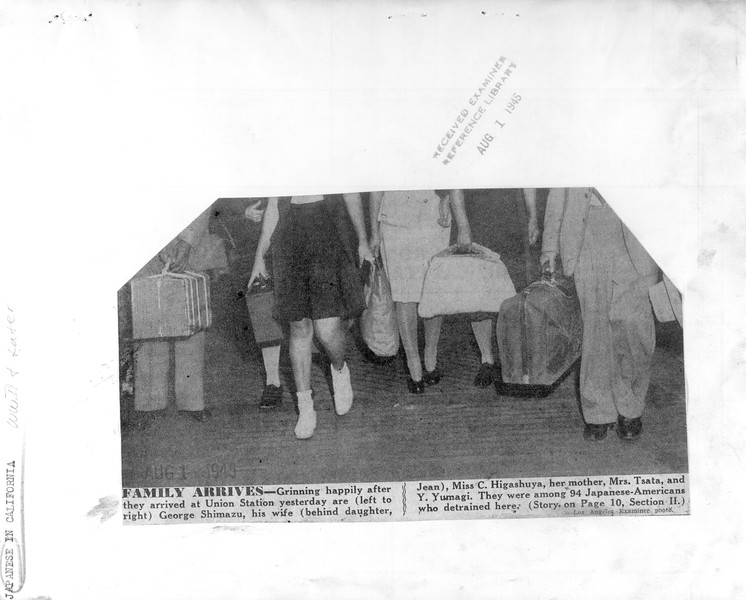 """""""Family Arrives -- Grinning happily after they arrived at Union Station yesterday"""" -- caption on photograph"""