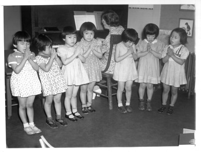 """Mrs. F.A. Vickland, an American, conducting a class of five-year-olds in the Japanese kindergarten school operated by the Japanese Christian Church of Los Angeles.""--caption on photograph"