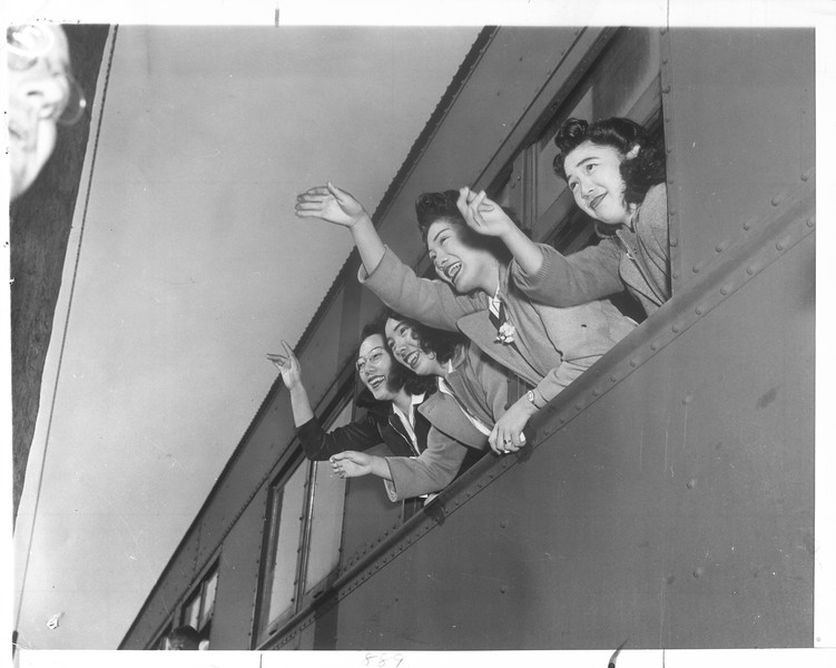 """Waving farewell as the train leaves are, left to right, Misao Natsumeda, her sister, Takeko Natsumeda, Mary Miyao, and Yori Sugimoto.""--caption on photograph"