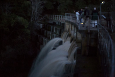Impressionistic treatment of the Searsville Dam and night hikers.