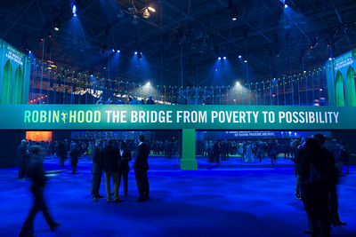 Guests walk along a replica of the Brooklyn Bridge as they arrive for the Robin Hood Foundation Benefit 2014 in New York on Monday, May 12, 2014.  Credit: Robin Hood Foundation