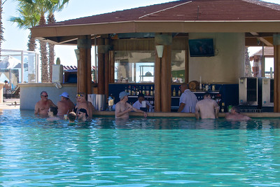 Jay in blue hat at swim up bar.
