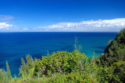 We hike the Kalalau Trail along the Na Pali Coast near Princeville.