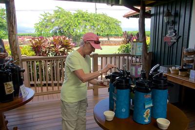 Toured Kauai coffe plantation. Donna trying some samples.