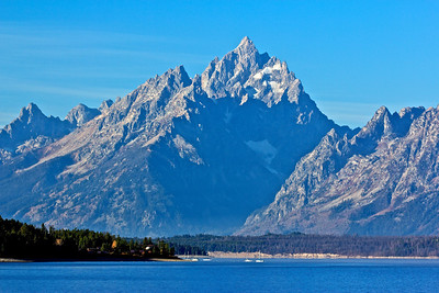 Taken at Jackson Lake dam. Jackson Lake is a huge reservoir in the park at the base of the Tetons. Grand Teton reaches to the sky.