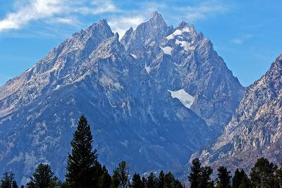 Taken on a hike near Jenny Lake, which is right at the base of the Tetons. Grand teton is 13,770 ft.