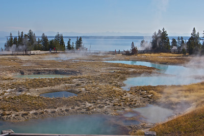Additional geyser pools in Yellowstone, Yellowstone Lake in background