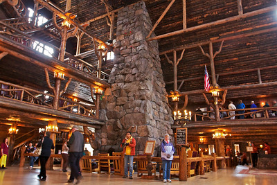 Donna inside the Old Faithful Inn, look at all the wood logs and the huge fireplace.