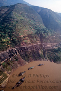 Boats line up in Qutang Gorge on the Yangtze River near Fengjie, China, on October 28, 1995, for Jay Cochrane's Great China Skywalk.