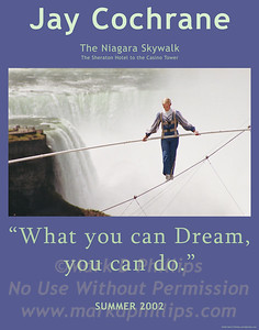"""Jay Cochrane skywalks on Clifton Hill in Niagara, Canada, in 2002. The first skywalk in over a hundred years went from the pinnacle of the Sheraton on the Falls Hotel to the Casino Niagara Tower at a height of 40 stories, with Niagara Falls as the backdrop. """"Skywalk at Niagara"""" was the highest skywalk ever completed in Niagara Falls."""