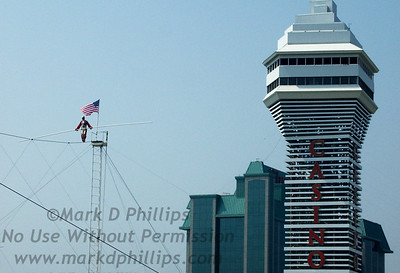 """Jay Cochrane, """"The Prince of the Air,"""" skywalks over Planet Hollywood in Niagara Falls, Ontario, at a height of 140 feet and 300 feet across with the American Falls in the distance on 25 June 2002. Cochrane will perform the walk three times daily from June 28 to Labor Day in """"Up Close and Personal with Jay Cochrane,"""" a summer of performances to raise money for the Tender Wishes Foundation of Niagara Falls."""
