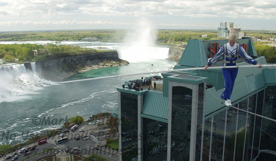 Jay Cochrane skywalks with the Canadian Falls at Niagara Falls as he completed the first skywalk in Niagara Falls since 1897. Jays walk covered a distance of 200 feet from the pinnacle of the Sheraton on the Falls Hotel to the Casino Tower in Niagara Falls, Ontario at a height of 40 stories on 21 May.