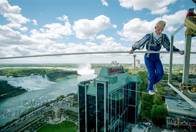 """In 2002 Jay Cochrane completed the first skywalk in over a hundred years in Niagara Falls, Canada. The skywalk went from the pinnacle of the Sheraton on the Falls Hotel to the Casino Niagara Tower at a height of 40 stories, with Niagara Falls as the backdrop. """"Skywalk at Niagara"""" was the highest skywalk ever completed in Niagara Falls."""