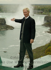 """Jay Cochrane, Canada's own """"Prince of the Air,"""" stands atop the Niagara Falls / Fallsview Hotel with the Horseshoe Falls beneath him on May 20, 2002. """"Skywalk at Niagara"""" on May 21, 2002, brought skywalking back to Niagara for the first time in a hundred years."""