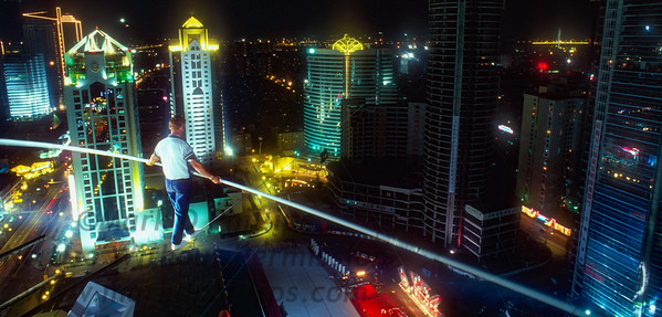 Jay Cochrane practices the night before his nighttime skywalk over the Pudong District of Shanghai for the 1996 Shanghai Tourism Festival.