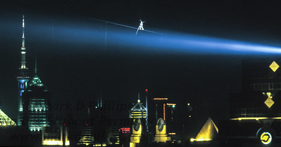 Canadian Jay Cochrane walks above the Pearl of the Orient Tower in Shanghai, China as he accomplished a world record for the highest and longest nighttime building-to-building wire walk on September 24, 1996 during the Shanghai Tourism Festival.