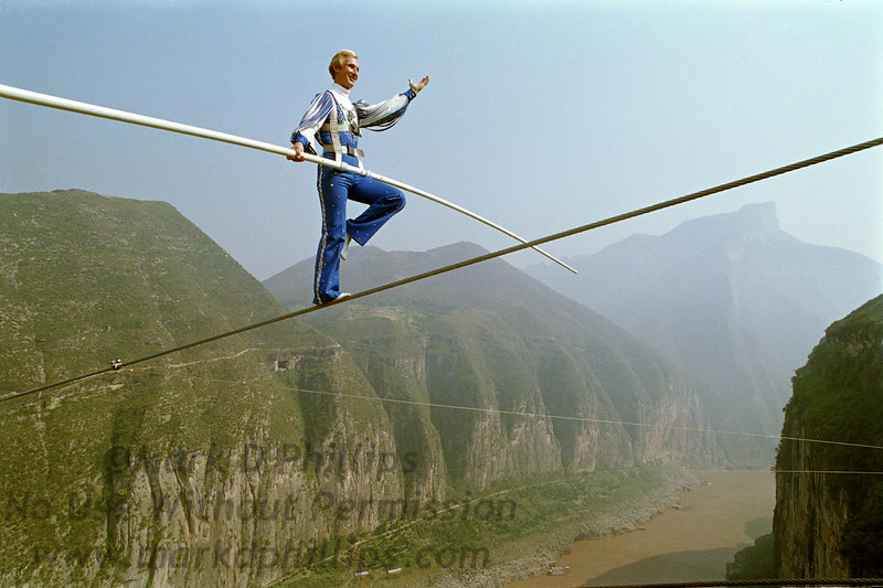 """Jay Cochrane, """"The Prince of the Air"""", completes The Great China Skywalk over the Yangtze River in Qutang Gorge, China, on October 28, 1995. The skywalk was and is the greatest ever made spanning half a mile between the canyon walls and 1,350 feet above the river."""
