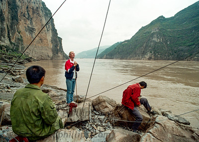 Jay Cochrane checks the guide lines along the banks of the Yangtze River in Qutang Gorge, China in 1995 in the days before his skywalk.