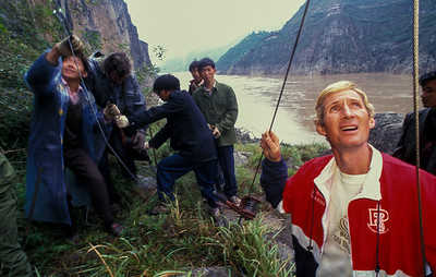 Jay Cochrane checks a guide wire for the Great China Skywalk over the Yangtze River deep in Qutang Gorge on October 19, 1995