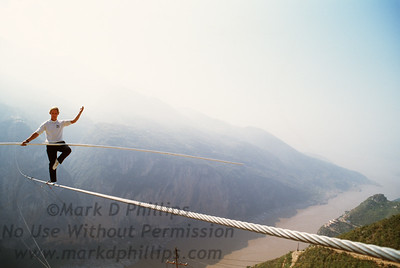 Jay Cochrane practices on the wire above the Yangtze River in Qutang Gorge (the Three Gorges of China) the day before The Great China Skywalk on October 27, 1995.