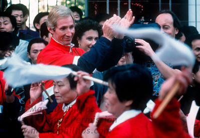 The Great China Skywalk took place in Qutang Gorge above the Yangtze River near Fengjie, China, on October 28, 1995. Jay cheers at parade in Fengjie.