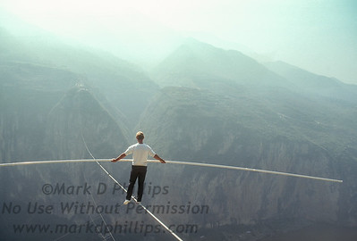 Jay Cochrane tests the wire the day before the Great China Skywalk in Qutang Gorge on October 27, 1995