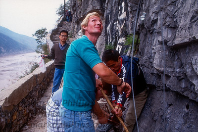Jay Cochrane works on guide wires along the Yangtze Rivier in Qutang Gorge attached to the skywire for the Great China Skywalk in 1995