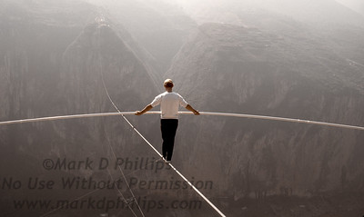 Jay Cochrane practices on the skywalk wire for The Great China Skywalk in Qutang Gorge, China, on October 27, 1995, the day before the actual performance.