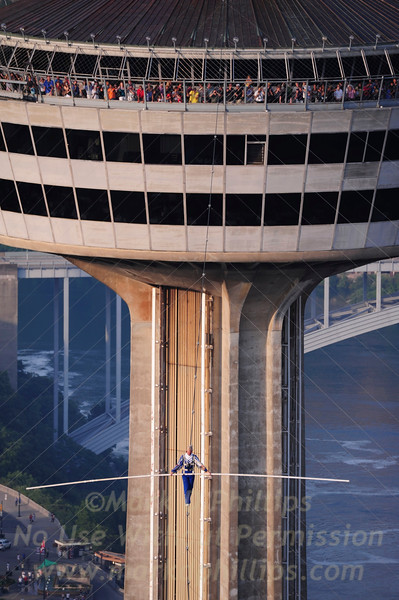 Jay Cochrane, skywalks in front of hundreds crammed into the observation deck of the Skylon Tower for the first day of Skywalk2012 on July 6, 2012. Jay completed his walk to the Hilton Fallsview Hotel, 1300 feet away in Niagara Falls, Canada.