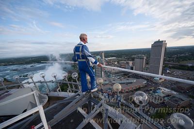 Jay Cochrane Skywalk2012 on July 20, 2012 from the Skylon Tower to the Hilton Fallsview Hotel, 1300 feet across in Niagara Falls, Canada atop the Skylon Tower