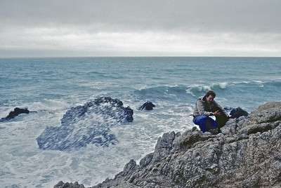 Jeff along the ocean, near Santa Cruz, with their dog Angel.