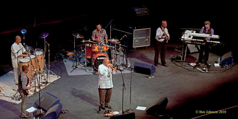 "Hugh Masekela Band Photo - Performing at TheZellerbach Theater - The Annenburg Center for The Arts on  The University of Pennsylvania Campus in Philadelphia on October 8, 2010.<br /> <br /> FRANCIS MANNEH FUSTER (PERCUSSION). ABEDNIGO ""FANA"" ZULU (BASS), RANDALL SKIPPERS (KEYBOARDS), LEE-ROY SAULS (DRUMS),  CAMERON JOHN WARD (GUITAR"